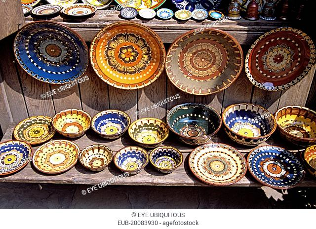 Traditional Bulgarian pottery on display outside gift and craft shop