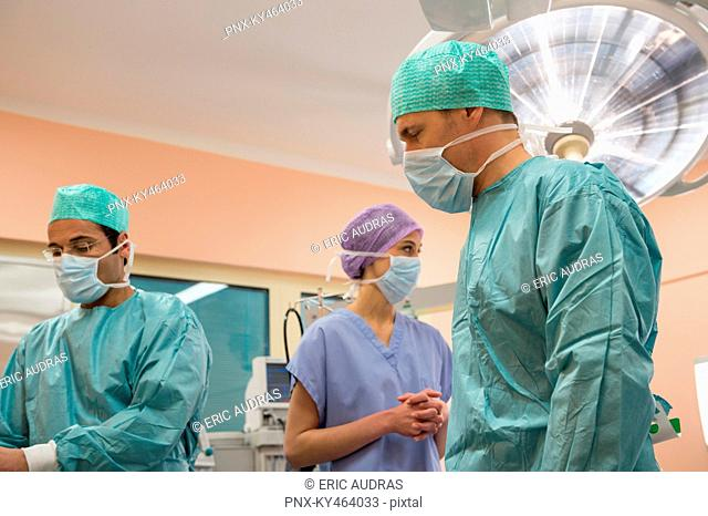 Medical team preparing for an operation in an operating room