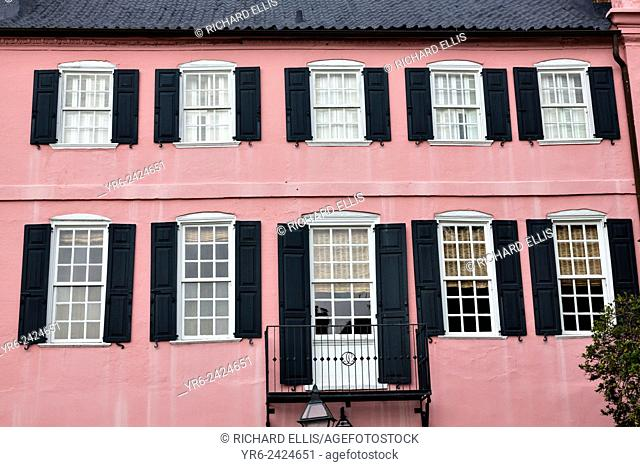 A pink building facade on Rainbow Row along East Bay Street in historic Charleston, SC