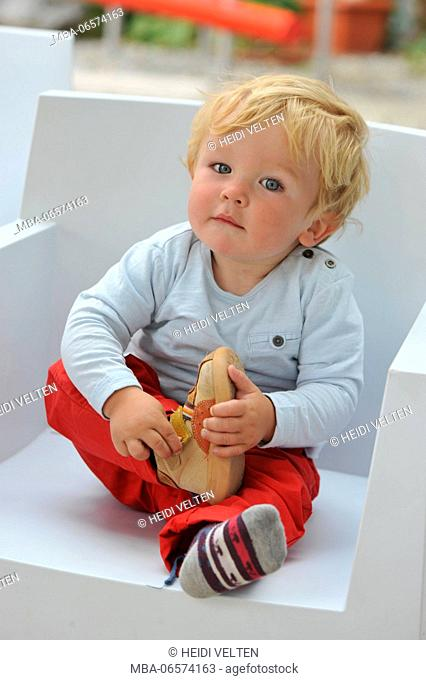Toddler, taking off shoes