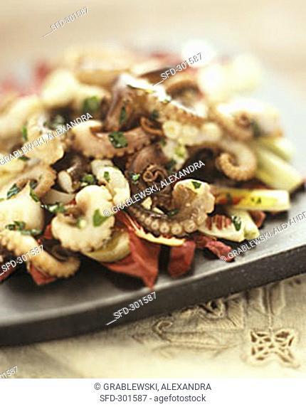 Squid salad on radicchio leaves
