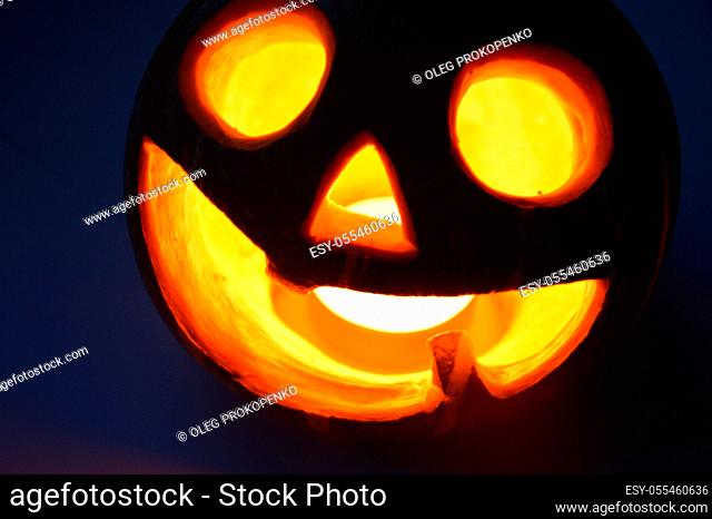 Lighted pumpkin-shaped candle for halloween the burning