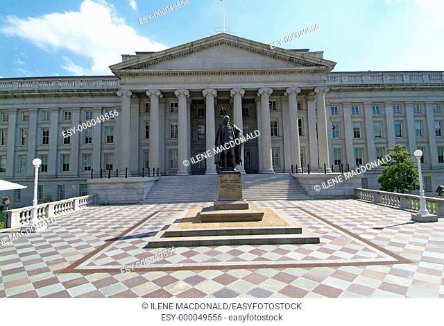 Building of US Treasury Deptartment and statue of Alexander Hamilton. Washington DC. USA
