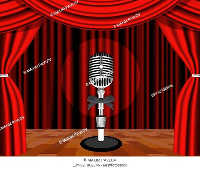 A microphone on a stage with a spotlight on it