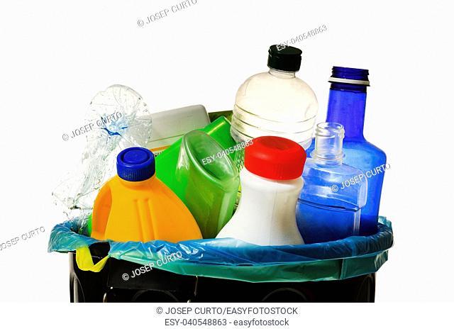 garbage bin full of bottles to recycle on white