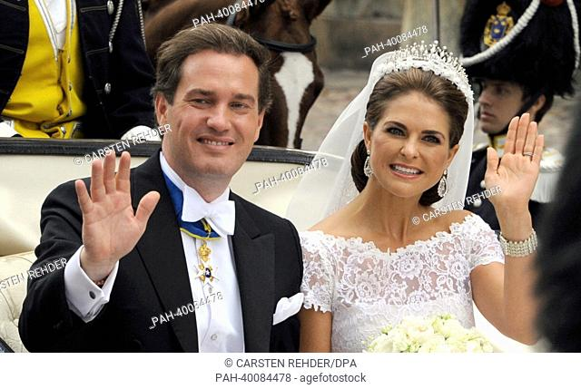 Swedish Princess Madeleine and her husband Chris O'Neill drive in a carriage from the Royal Palace to Riddarholmen after their wedding in Stockholm, Sweden