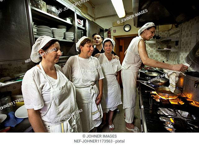Women preparing food in restaurant