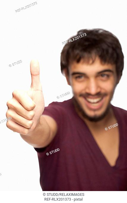 Young man teenager Portrait Thumbs up happy sign