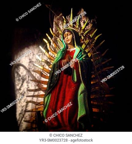 An image of Our Lady of Guadalupe displayed in an altar in Mexico City, Mexico