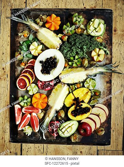 Various fruits on a vintage tray Healthy greens