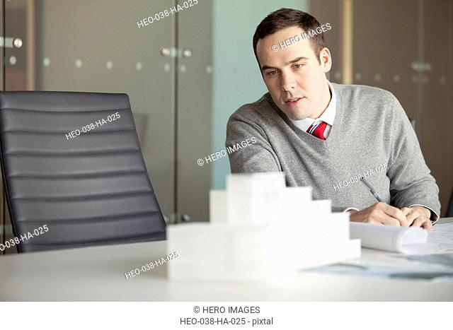 young architect planning