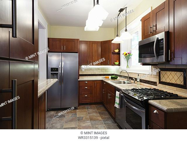 Appliances and cabinets in kitchen