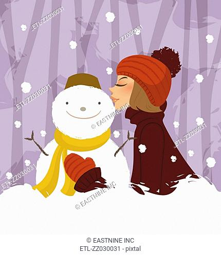Side profile of a woman kissing a snowman