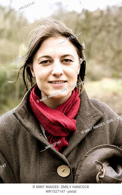 A young woman in a scarf and outdoor coat