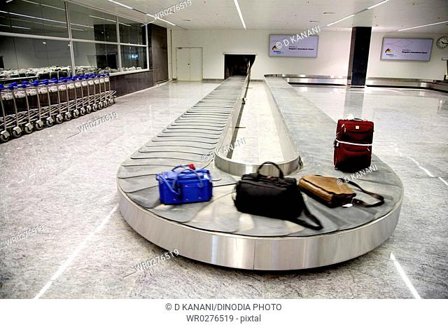 Baggage conveyor belt system area of airport trolley for passengers and luggage inside Bengaluru international airport
