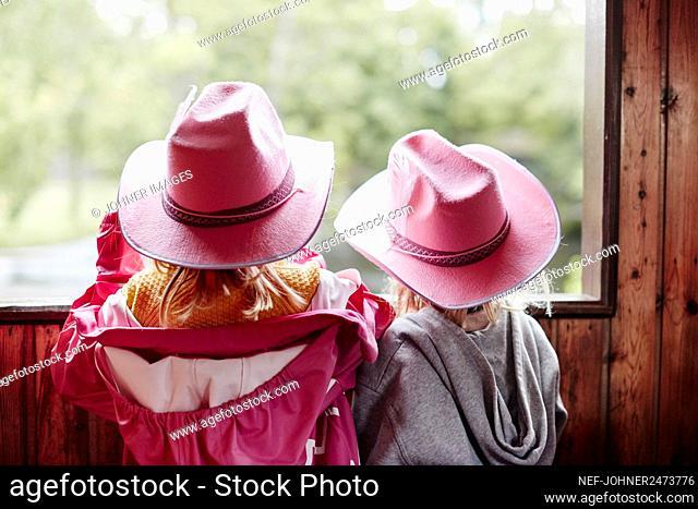 Girl wearing pink cowboy hats