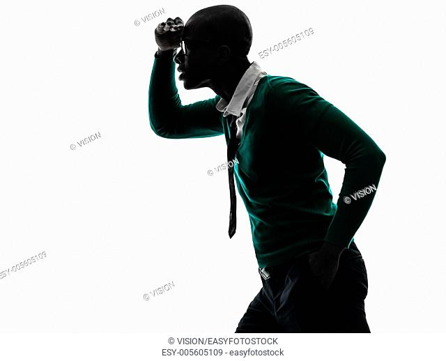 one african black man looking away worried in silhouette studio on white background
