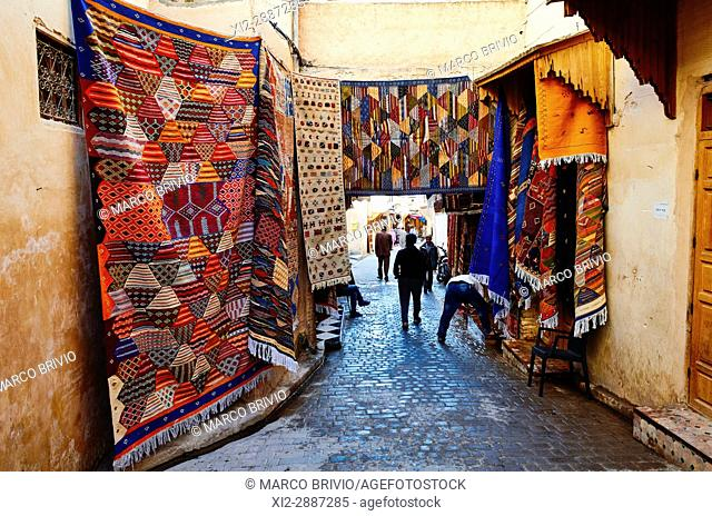 Moroccan carpets for sale in the streets of the medina of Fez, Morocco
