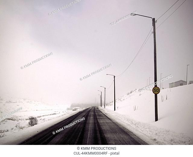 Street lights in snowy landscape