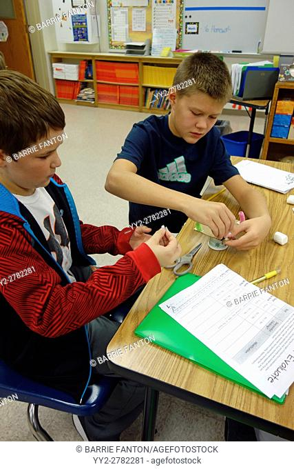 6th Grade Boys Working on Science Project, Wellsville, New York, USA