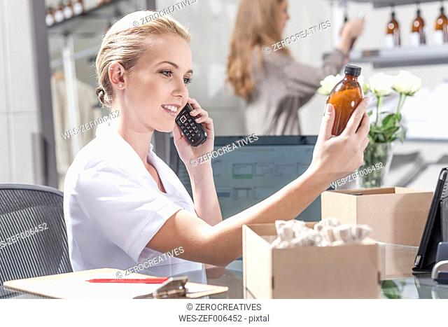 Shop assistant on the phone in wellness shop