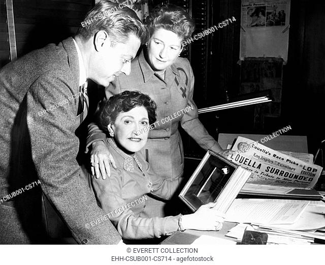 Louella Parsons, Hollywood gossip columnist, with CBS-TV Producer, Martin Manulis. They are discussing last minute details of a 1956 TV show