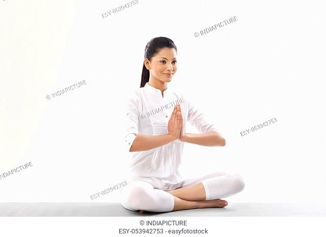 Woman with hands joint looking away