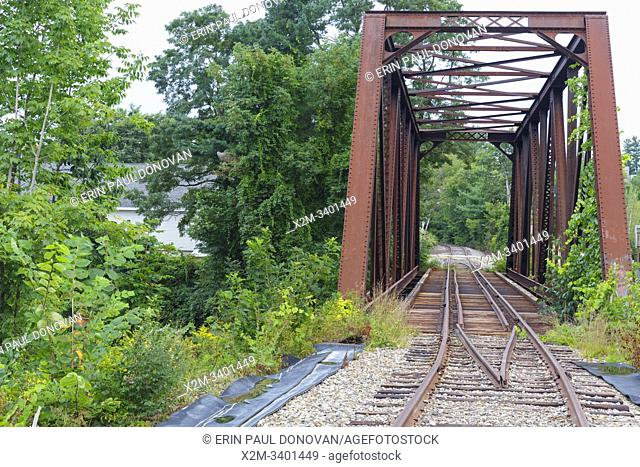 Trestle along the old Boston & Maine Railroadâ. . s Pemigewasset Valley Railroad in Plymouth, New Hampshire. This trestle crosses the Baker River, near todayâ