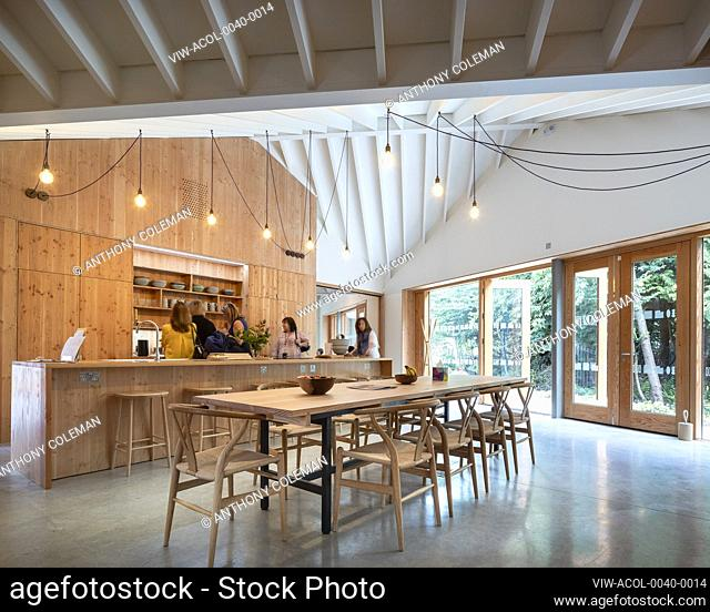 Kitchen and dining area. Maggie's Centre at Velindre Hospital, Cardiff, United Kingdom. Architect: Dow Jones Architects, 2019