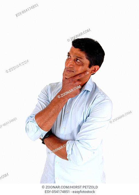 A close up image of a very serious man with his hand on his chin looking confused and puzzled, isolated for white background