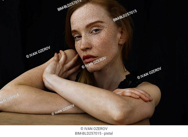 Close up of serious Caucasian woman with freckles