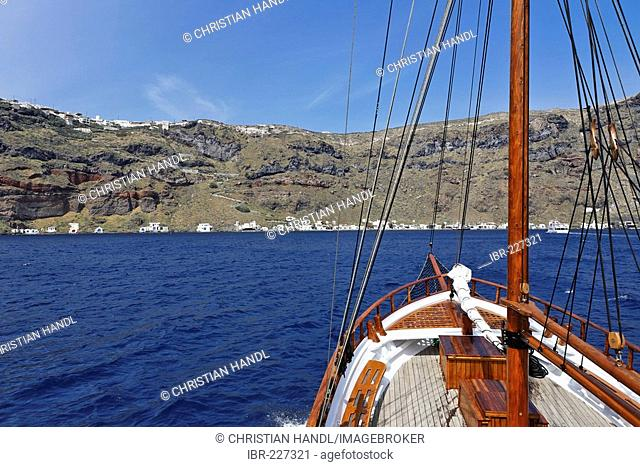 View from a sailing ship to the walls of the caldera, Santorini, Greece