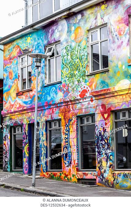 A beautiful, artistically painted building in downtown Reykjavik, typical of the artsy neighbourhoods that have many grafitti and art covered buildings;...