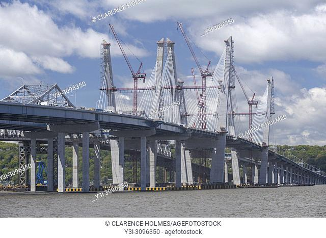 Tower cranes work to complete the cable towers on New Tappan Zee Bridge over the Hudson River between Westchester and Rockland counties