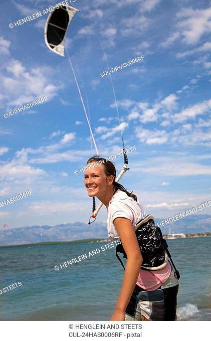 Kitesurfer getting kite ready