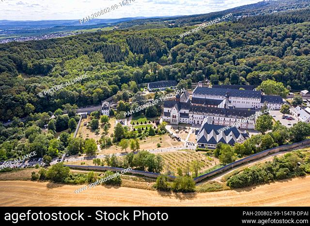 02 August 2020, Hessen, Eltville: The green outdoor areas of Eberbach Monastery in the Rheingau region (aerial photograph taken with a drone) dry out in mild...
