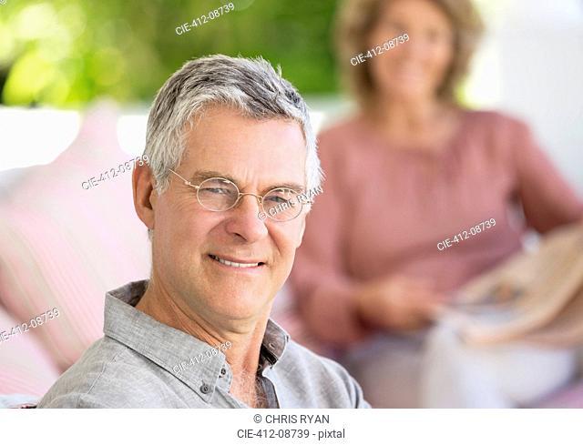 Portrait of smiling senior man on patio