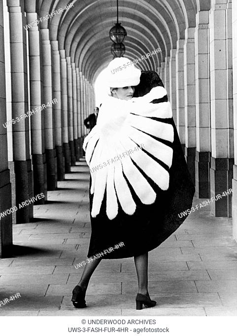 London, England: May, 1971 A model for Eurofur of Padua shows off a Russian wolverine cape with a matching hat at the Savoy Hotel