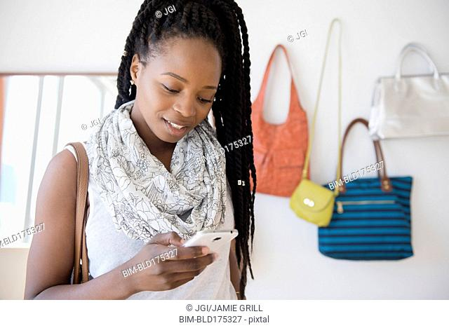 Black woman using cell phone