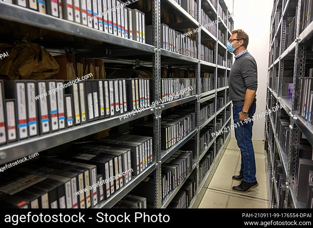 11 September 2021, Berlin: At the Open Monument Day at the former Stasi headquarters, Christian Appl, a member of the digitization staff at the Stasi Records...
