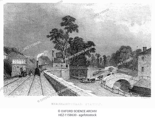 Berkhamsted Station, Hertfordshire, on the London and Birmingham Railway, c1860. On top of the building on the left is a water tank for supplying locomotives...
