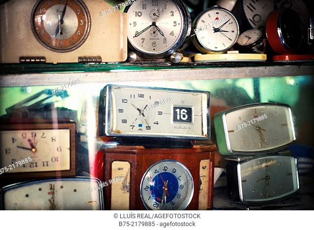 Shelves full of watches in a watchmaker to be repair in the Medina of Fez, Morocco, Africa