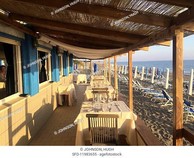 The sunny terrace of a beach restaurant