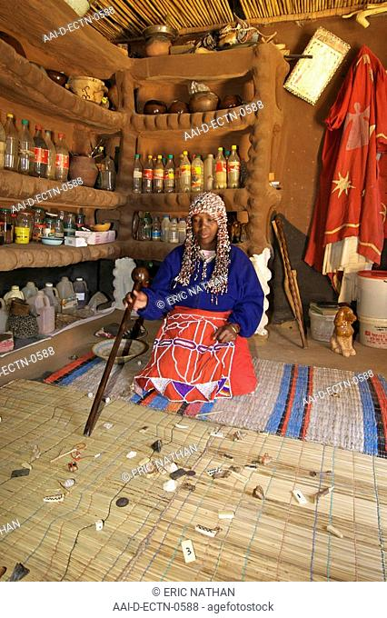 A traditional sangoma, throwing and then reading various objects in her consultation room in her home in the township of Refilwe near Cullinan in South Africa