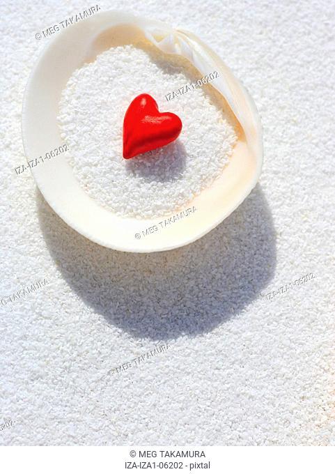 Close-up of a heart shape stuffed in a seashell
