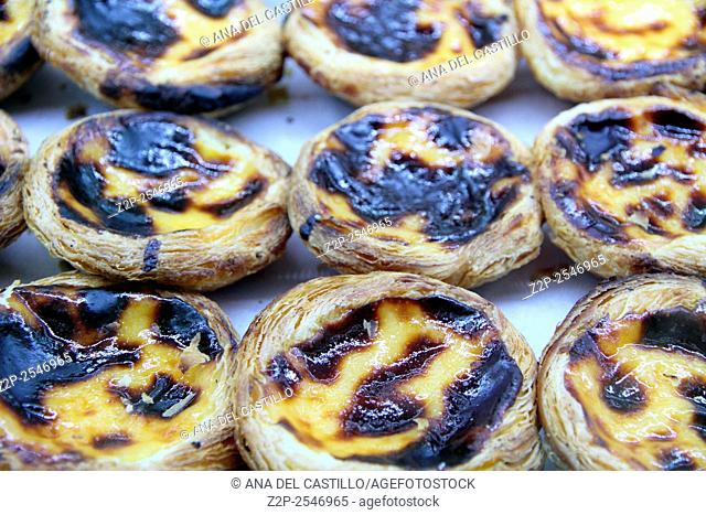 Portuguese egg tart pastry - pastel de nata - on showcase in Lisbon, Portugal
