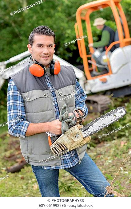Landscape gardener with a chainsaw