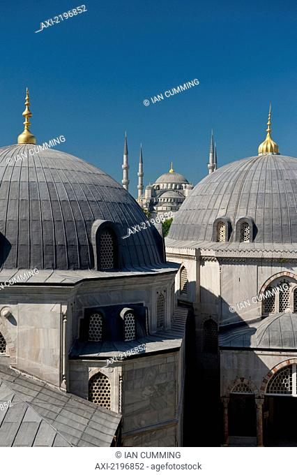 Looking across domed roofs of Haghia Sophia to Sultanahmet or Blue Mosque; Istanbul, Turkey