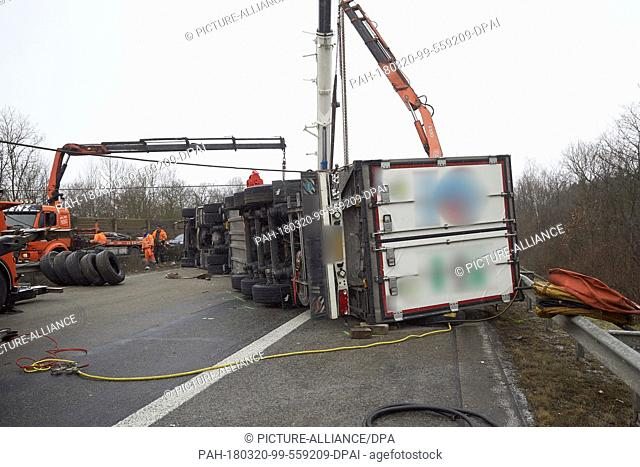 20 March, Germany, Boppard: Recovery workers attempt to right a juggernaut carrying beef which overturned on the Autobahn 61 (A61) motorway near Boppard