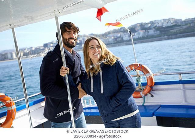 Couple on a boat trip to Santa Clara Island, La Concha Bay, Donostia, San Sebastian, Gipuzkoa, Basque Country, Spain, Europe, Winter